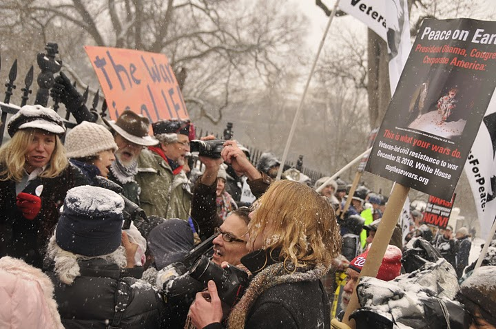 VFP President Mike Ferner and others on the fence in front of the White House prior to being arrested December 16.