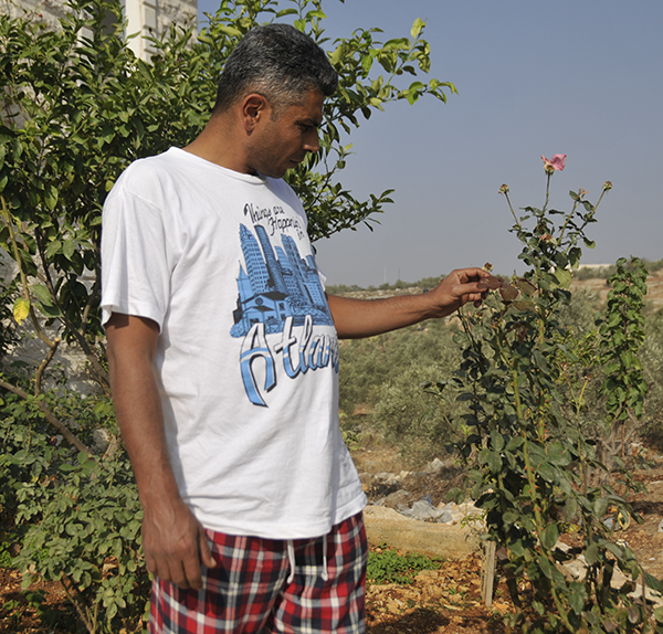 Bil'in Popular Committee leader Iyad Burnat, in his garden. Photo by ELLEN DAVIDSON