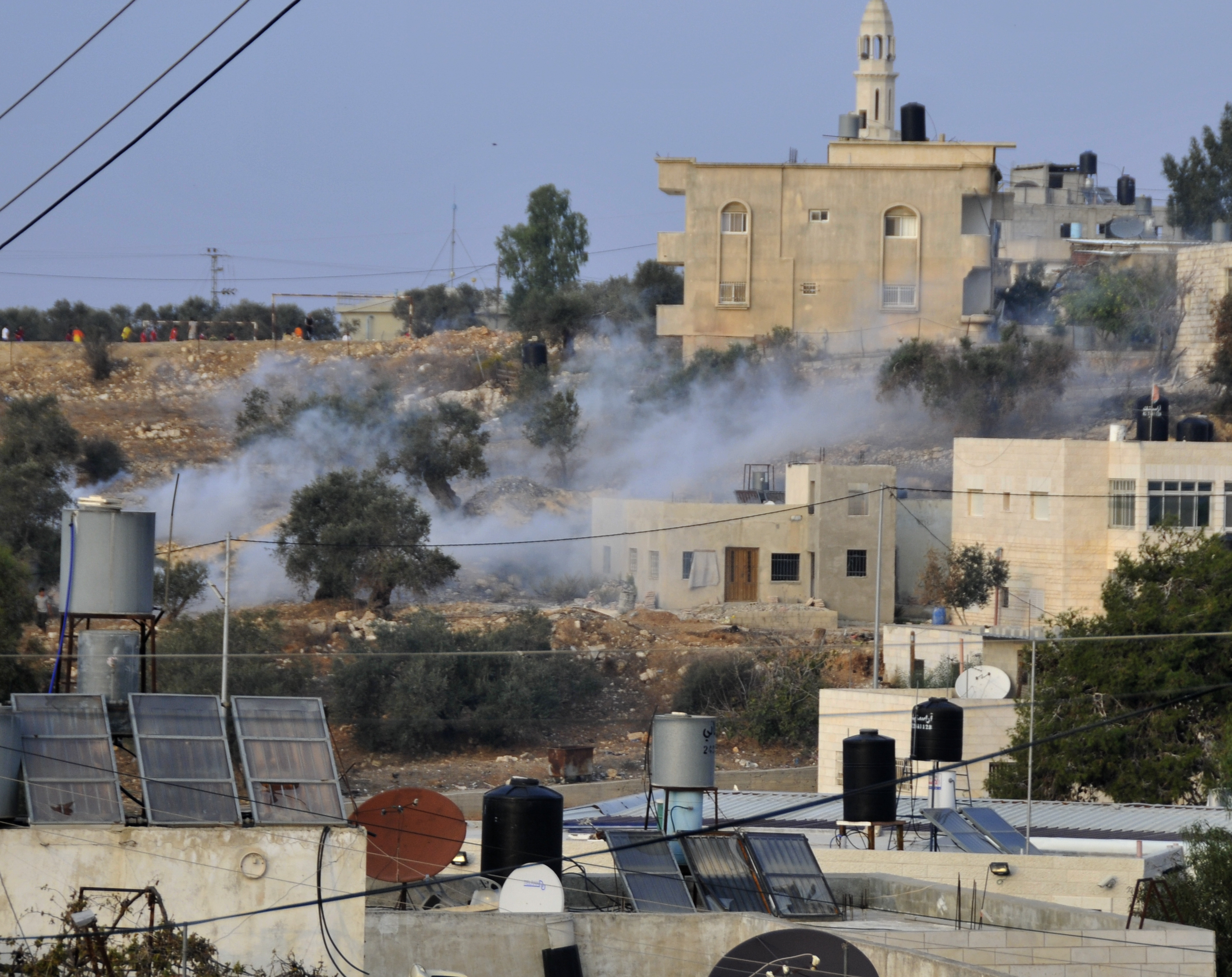 Tear gas drifts into the windows of the home in the village of Nabi Salih. Photo by ELLEN DAVIDSON