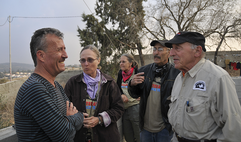 Nabi Salih Popular Committee leader Bassem al-Tamimi with members of the Veterans Peace Team. Photo by ELLEN DAVIDSON