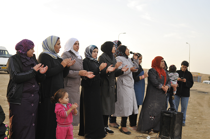 Women lead the chants at the weekly vigil in Al-Araqeeb. Photo by ELLEN DAVIDSON