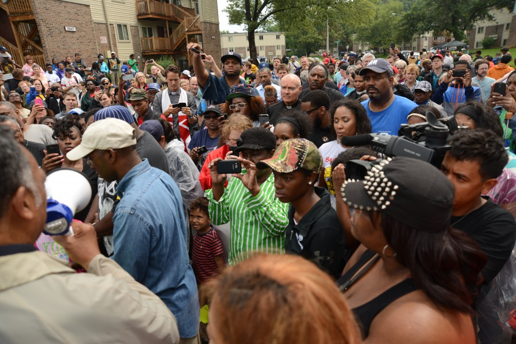 Rev. Jesse Jackson addresses the rally at the site where Michael Brown, Jr., was killed. Photo by ELLEN DAVIDSON