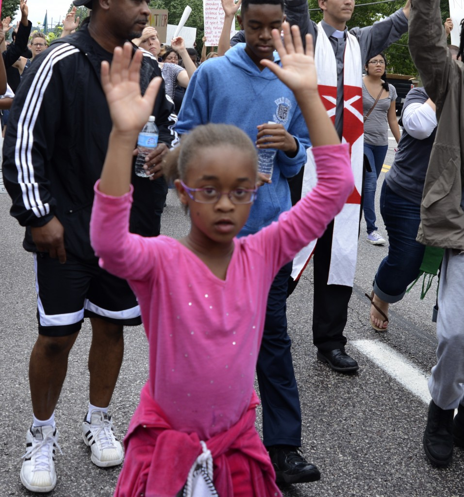 "Young marcher shows her ""Hands up, don't shoot!"" technique. Photo by ELLEN DAVIDSON"